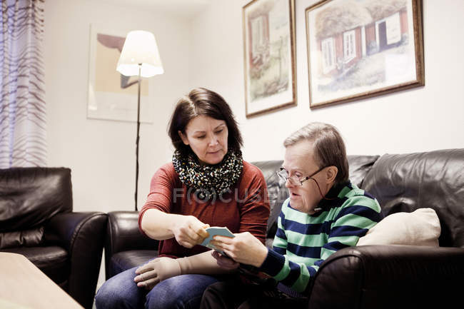 Healthcare worker assisting senior man — Stock Photo