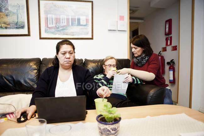 Mentally challenged woman using laptop — Stock Photo