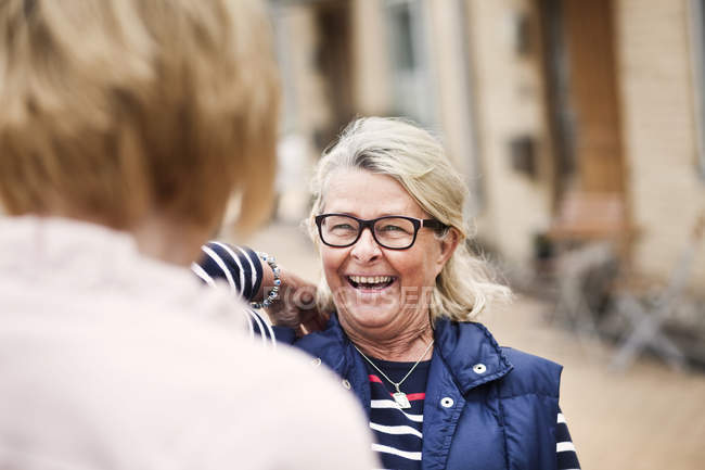 Senior woman looking at female friend — Stock Photo