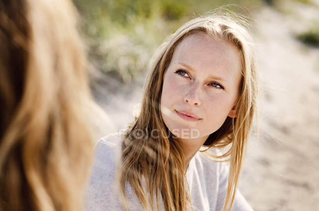 Woman looking at female friend — Stock Photo