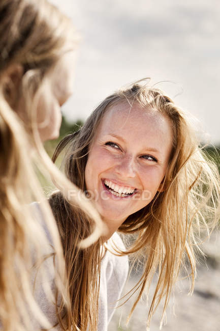 Cheerful woman looking at friend — Stock Photo