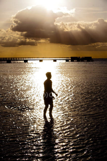 Young man standing in sea — Stock Photo