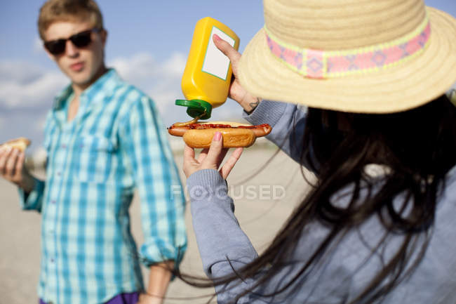 Teenage boy looking at woman — Stock Photo