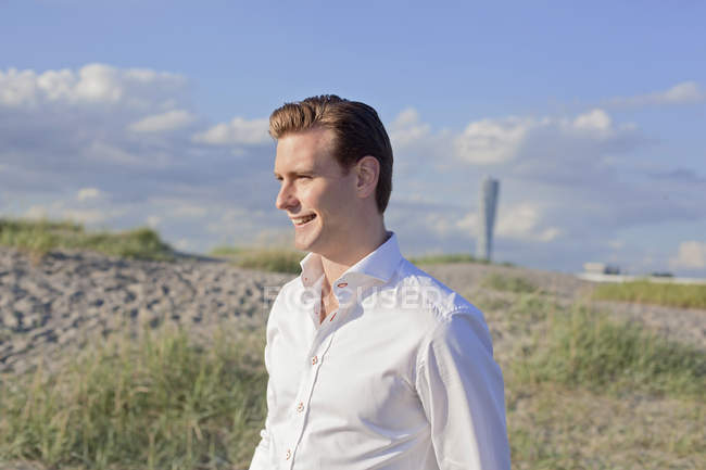 Man standing on field — Stock Photo