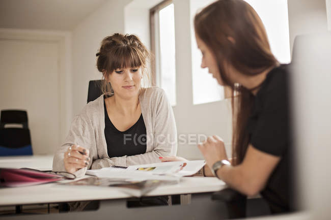 Businesswomen discussing about magazine — Stock Photo