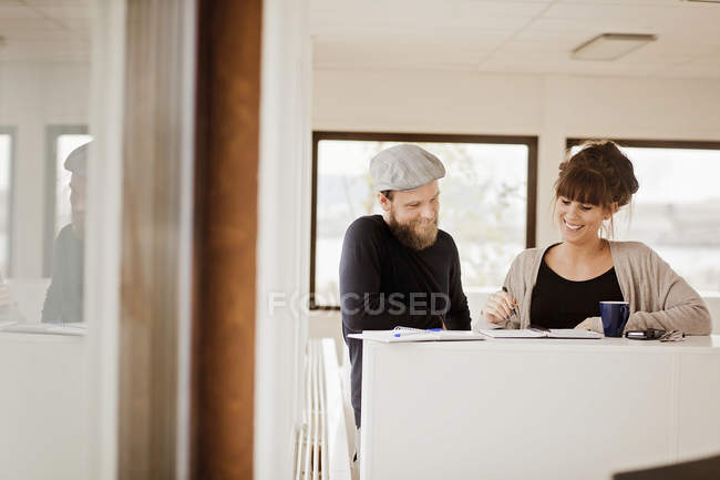 Woman discussing with man during meeting — Stock Photo