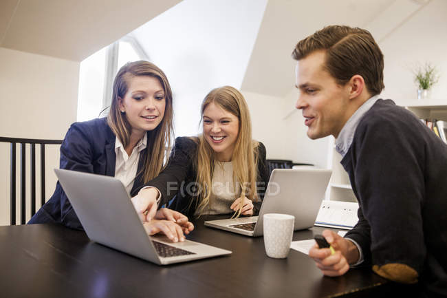 Happy young businessman and women — Stock Photo
