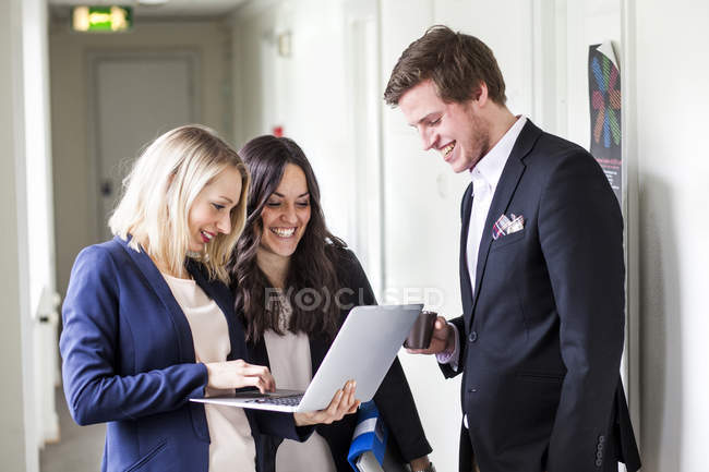 Happy male and female business colleagues — Stock Photo