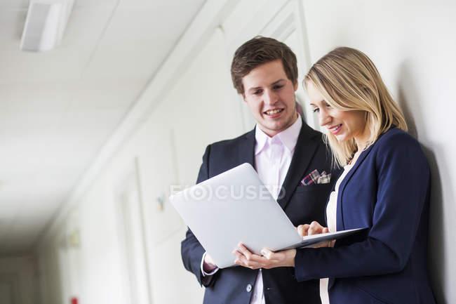 Happy businessman and businesswoman — Stock Photo