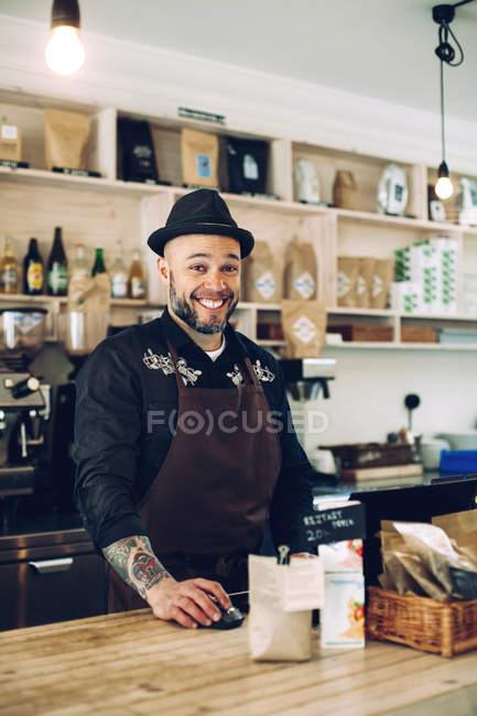 Smiling male barista — Stock Photo