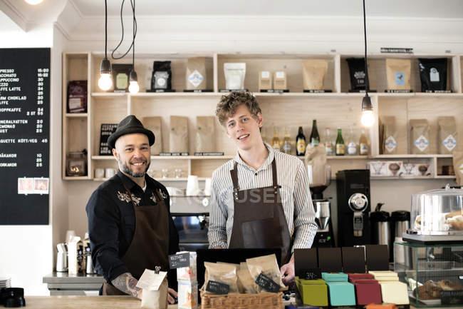 Confident male baristas — Stock Photo