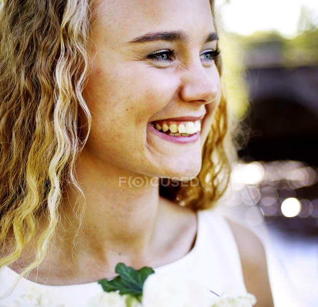 Portrait of cheerful blonde bride looking away — Stock Photo