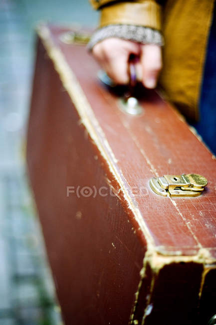Person carrying suitcase — Stock Photo