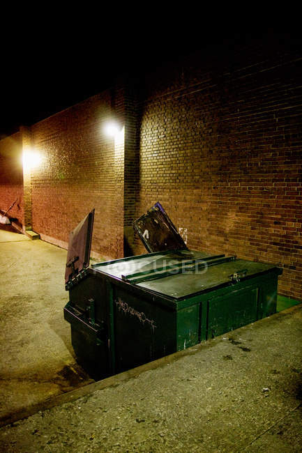 Garbage can on street at night — Stock Photo