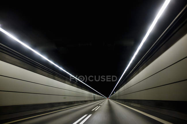 Light trails on road at night — Stock Photo