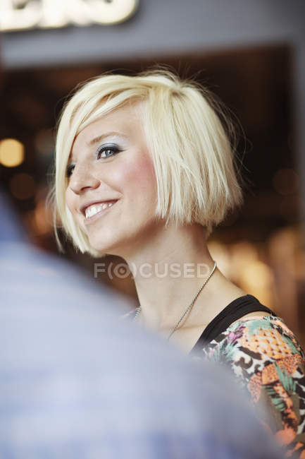 Young woman at shopping mall — Stock Photo
