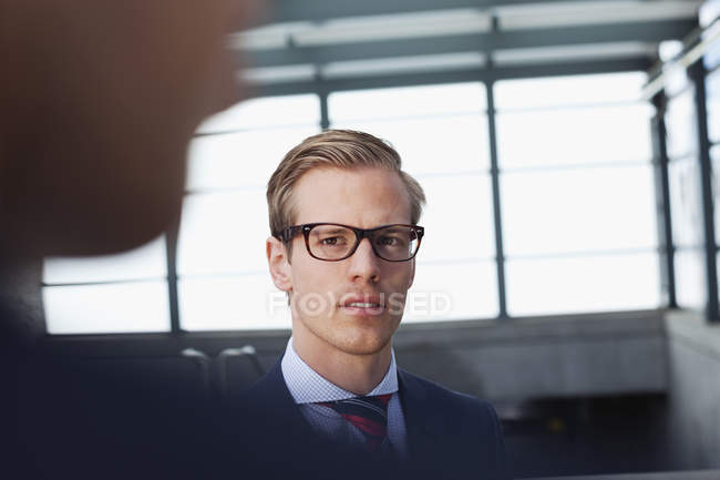 Businessman looking at coworker during meeting — Stock Photo