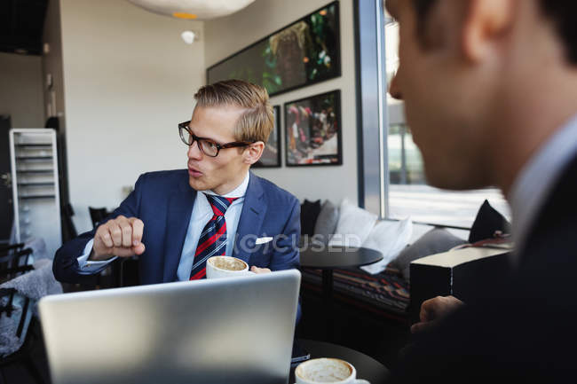 Coworkers sitting in cafe — Stock Photo