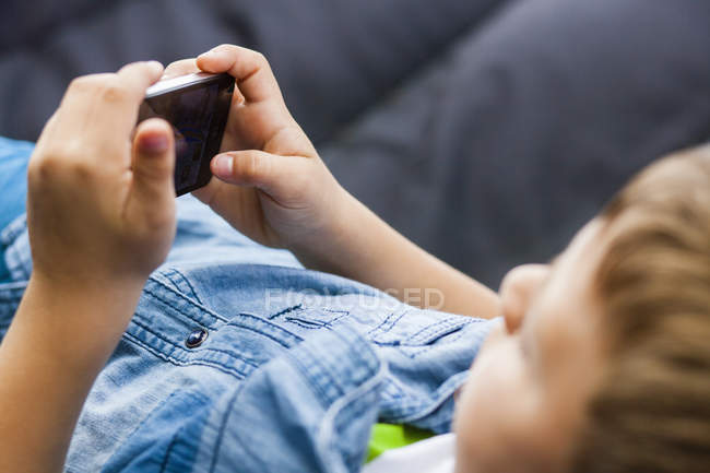 Boy using mobile phone — Stock Photo