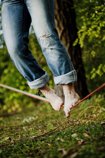 Man balancing on tightrope — Stock Photo