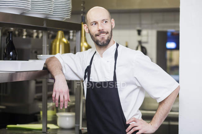 Chef looking away at commercial kitchen — Stock Photo