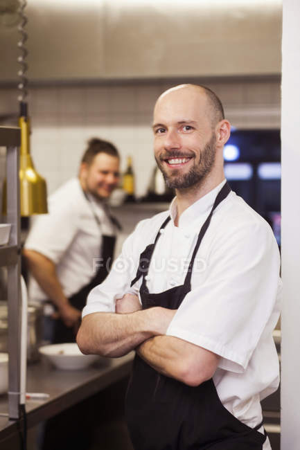 Happy chef standing arms crossed — Stock Photo