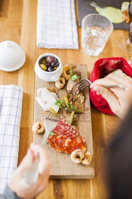 Friends having food at restaurant table — Stock Photo
