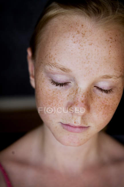 Portrait of girl with freckles and eyes closed — Stock Photo