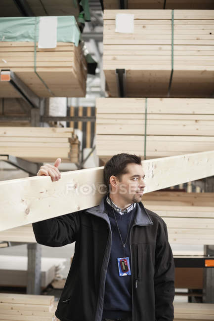 Man carrying wood — Stock Photo