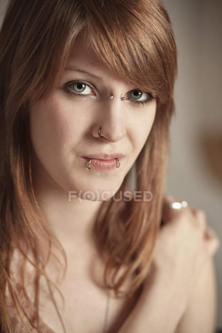 Young woman with piercings — Stock Photo