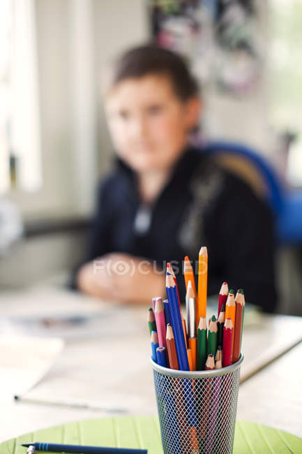 Colored pencils in container — Stock Photo