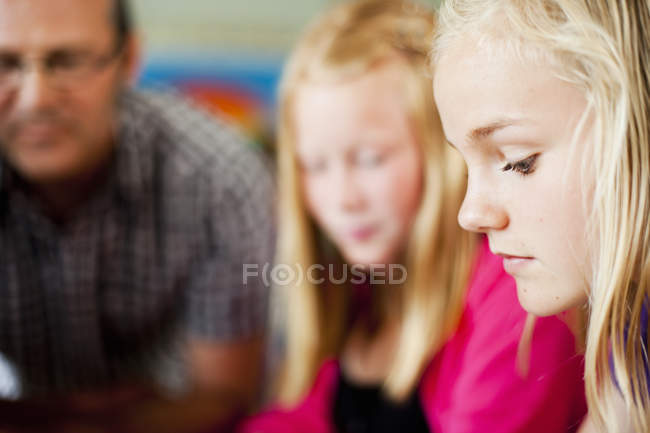 Girl with friend and professor — Stock Photo