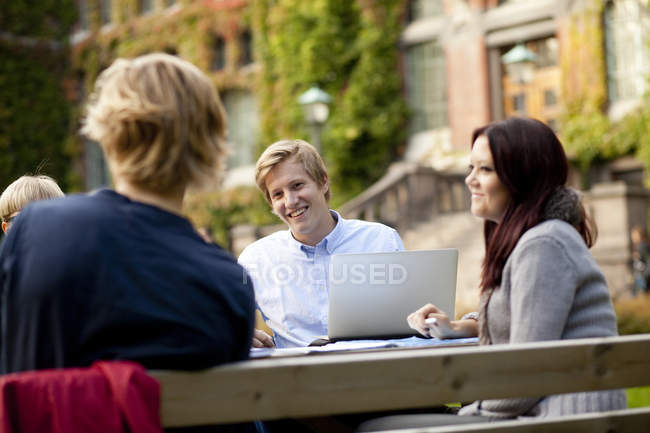 Happy young university students — Stock Photo
