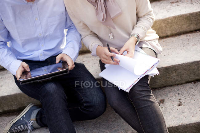 Friends studying with digital tablet — Stock Photo