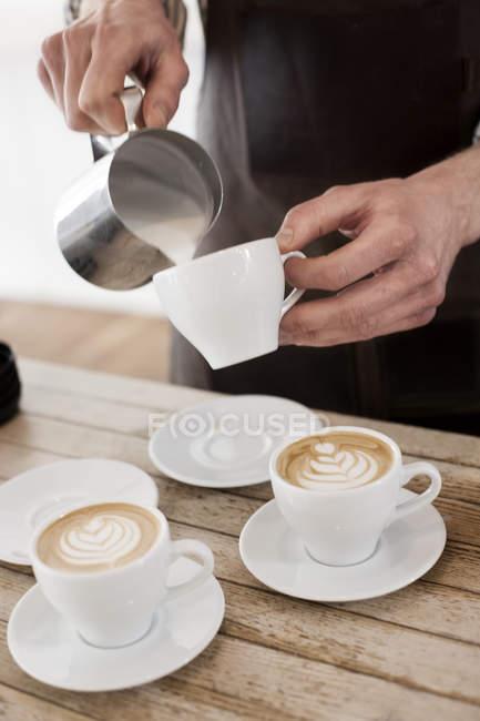 Barista making cappuccino — Stock Photo