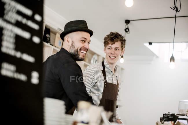 Baristas working in coffee shop — Stock Photo