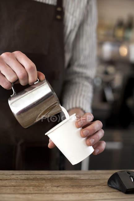Barista preparing cappuccino — Stock Photo