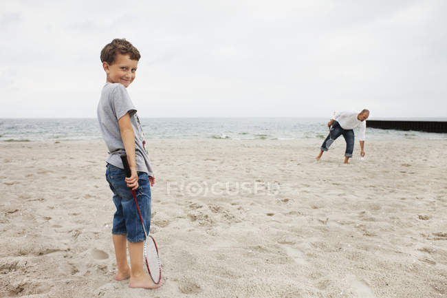 Portrait of boy standing with father — Stock Photo