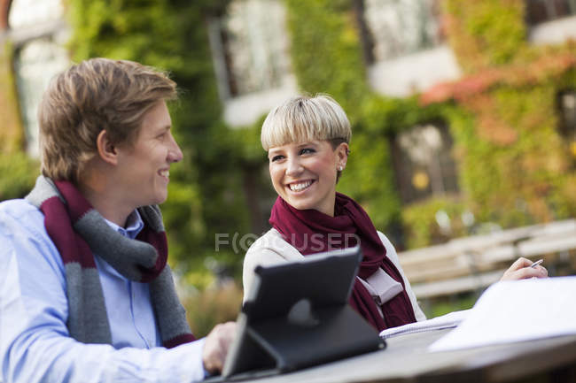 Happy friends with digital tablet — Stock Photo