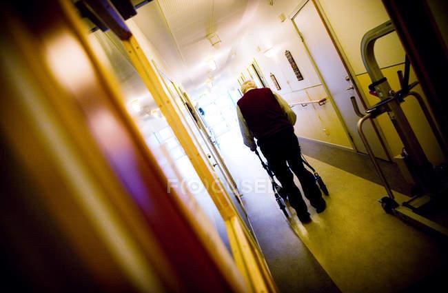 Senior man walking with rollator — Stock Photo