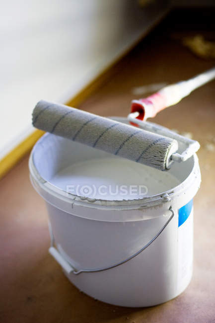 Paint roller on can at home — Stock Photo