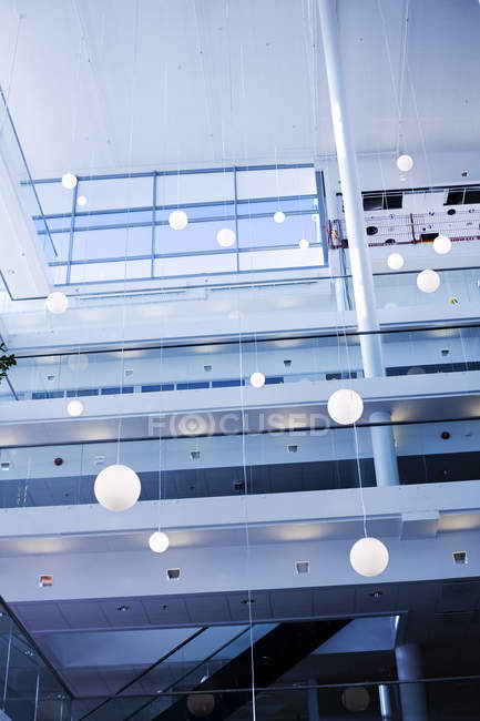Pendant lights hanging in modern building — Stock Photo