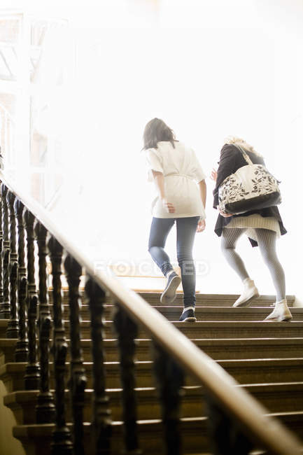 Women moving up steps — Stock Photo