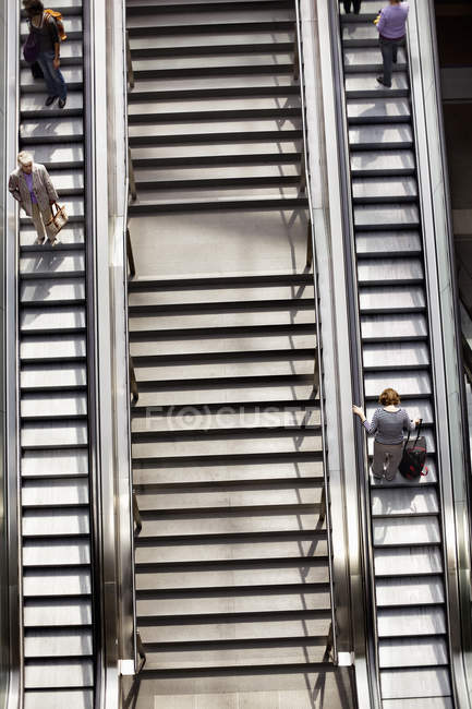 High angle view of people on escalators — Stock Photo
