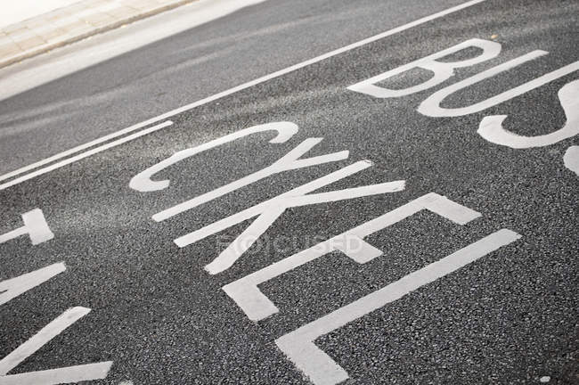 High angle view of text on road — Stock Photo