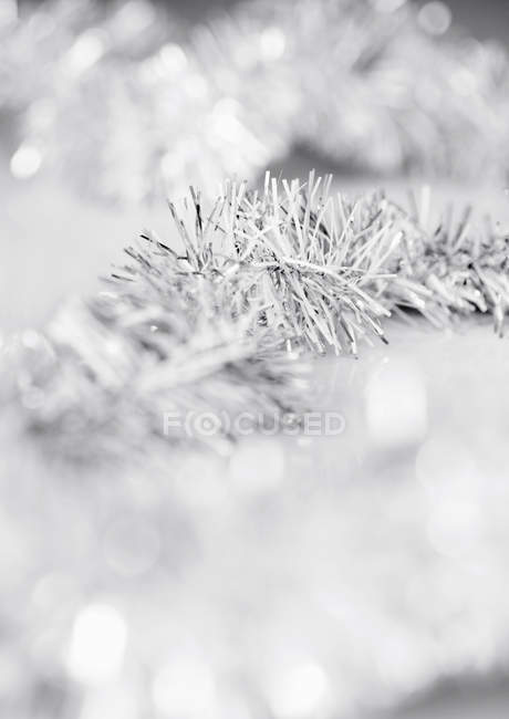 Silver tinsels on white — Stock Photo