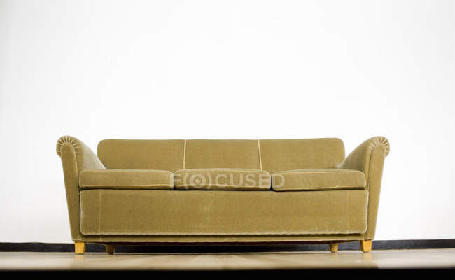 Sofa against white wall — Stock Photo