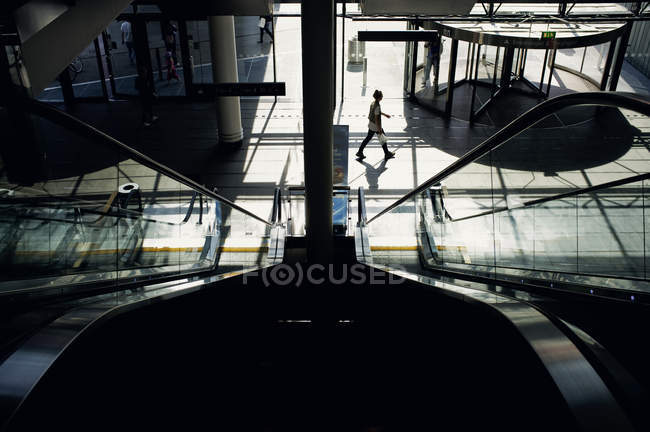 Woman walking in modern building — Stock Photo