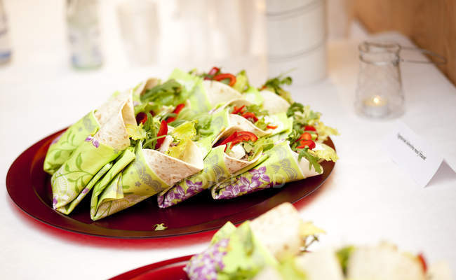 Wraps in plate on dining table — Stock Photo