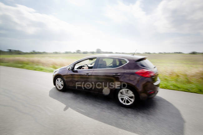 Car moving on country road — Stock Photo